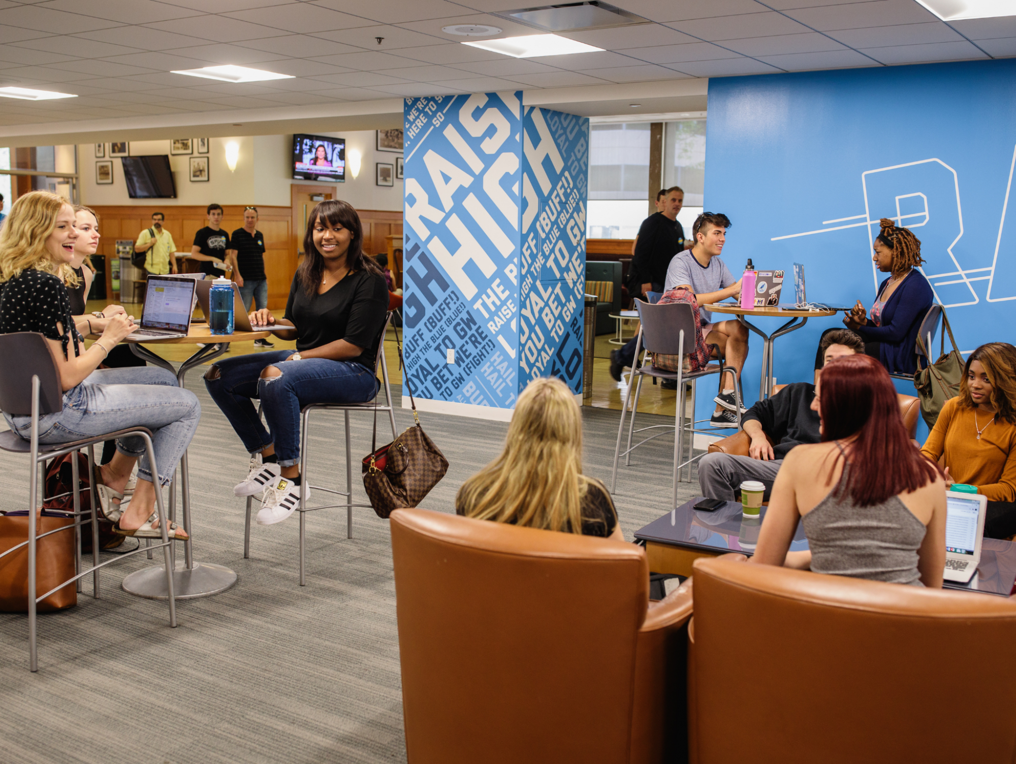 Students socializing in the Student Activities Center lobby in the Marvin Center