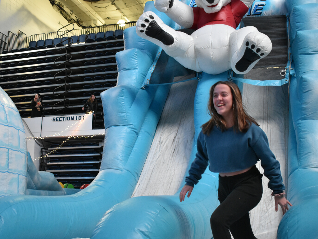 A student on the inflatable obstacle course at Midnight Breakfast