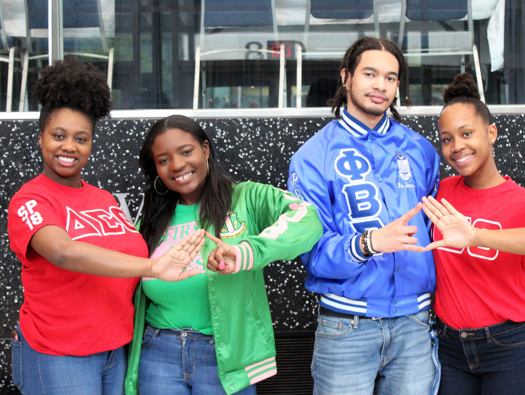 NPHC members standing in the Great Hall