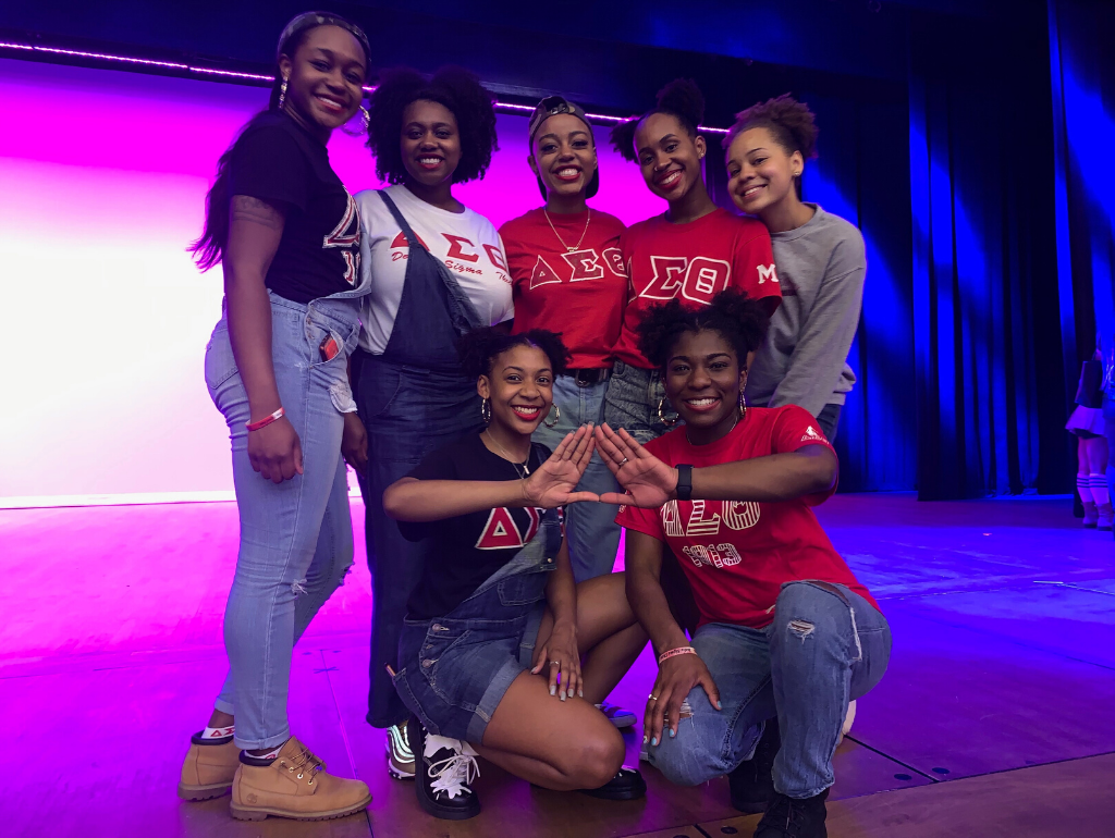 Members of Delta Sigma Theta posing on the Lisner Auditorium stage