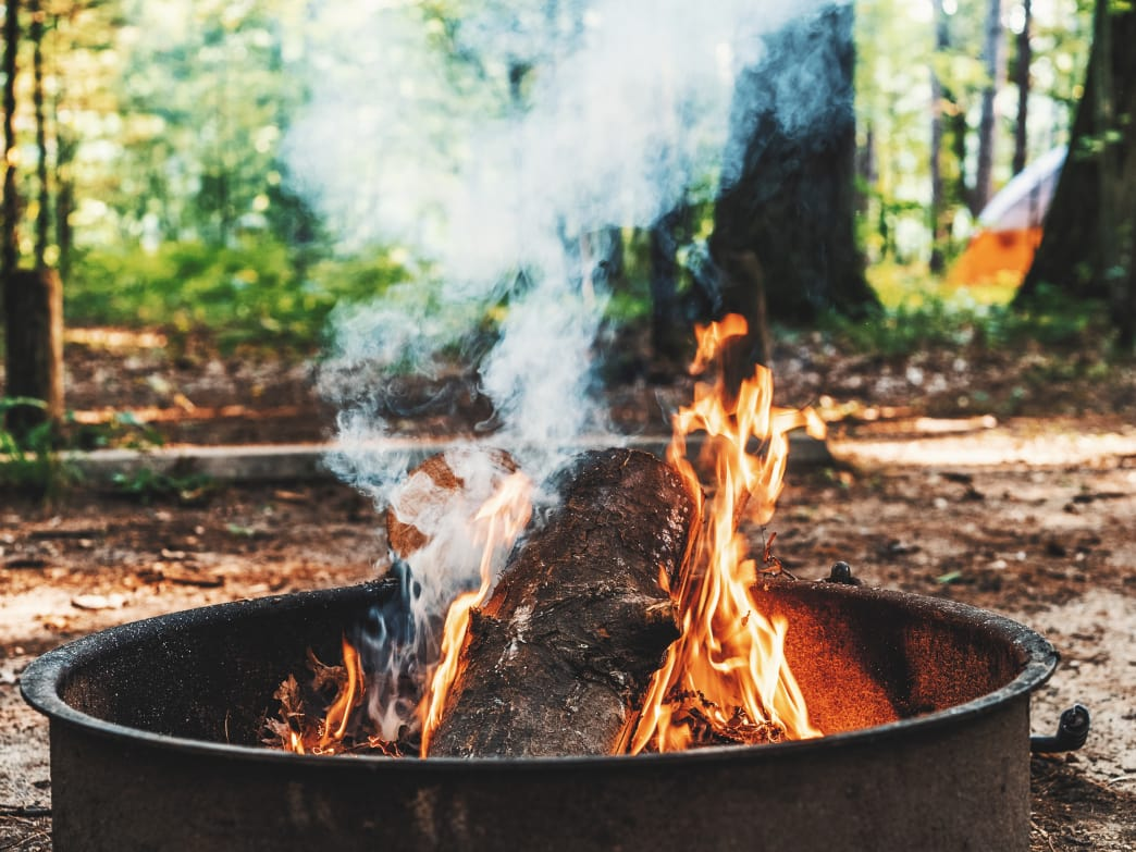 Photo of a campfire in a fire ring.