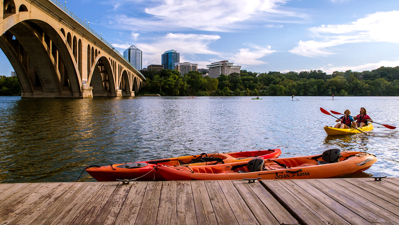 Two women in kayaks in the Potomac river.