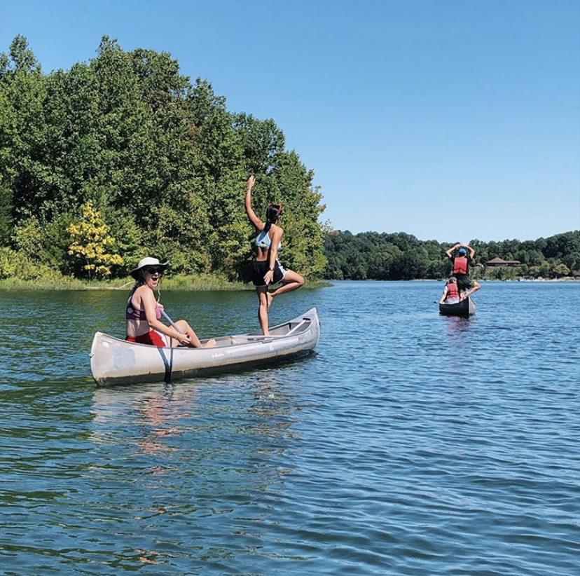 Students on a Trails trip in canoes at a lake.