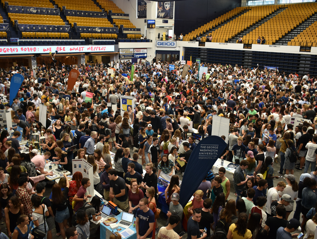 Overhead shot of hundreds of students navigating the fall org fair in the Smith Center
