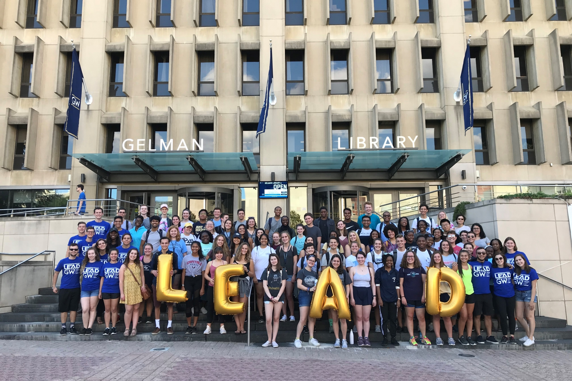 Around 80 LEAD participant and guides in front of Gelman Library in Kogan Plaza.