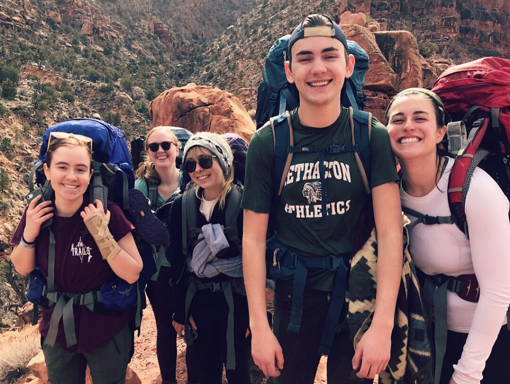 Students posing for a photo while backpacking